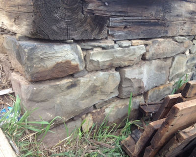 Hand cut barn stone under a colonial barn