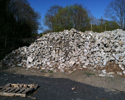 Salvaged granite cobblestone before sorting and palletizing