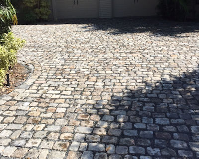 Random pattern gives an old world feel to this permeable stone driveway