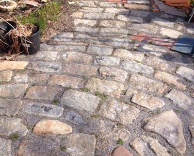 Rustic garden path created by laying stones on side