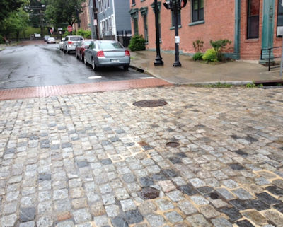 Historic district streetscape enhanced by cobblestone paving