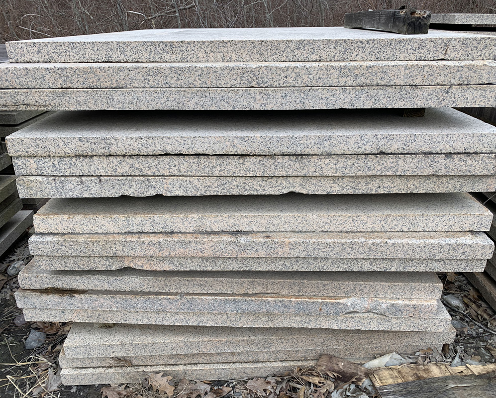 Our salvaged Heritage Plaza Pavers are stacked and ready for new life in your project.