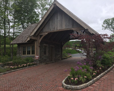 The herringbone installation pattern enhances this subdivision entrance