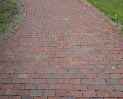 The mixture of brick types and brick installation patterns creates interesting pavement