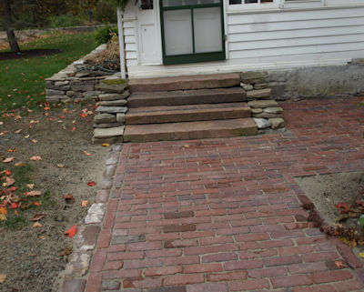 Sidewalk edged with Medina cobblestone leads to Medina curb steps