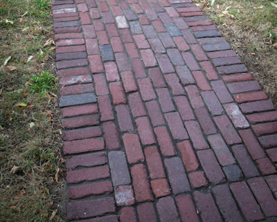 Reclaimed brick pathway with soldier course edging
