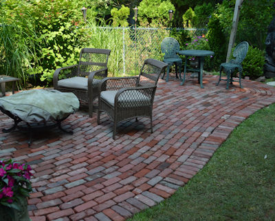 Permeable installation of used street brick patio