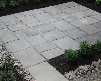 Old stone patio defines the open space in this garden