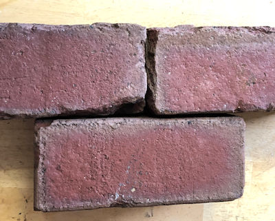 Occasionally reclaimed Metropolitan street bricks are a dark red