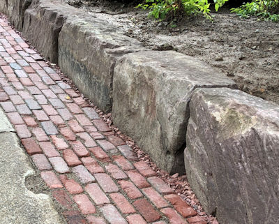 Reclaimed Medina Blocks from the Erie Canal used as a retaining wall